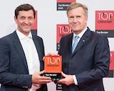 Top Consultant-Auszeichnung: Alexander Pifczyk, Dr. Kraus & Partner, und Christian Wulff