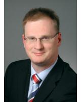 Dr. Günther Welsch steht auf der Systems Rede und Antwort.