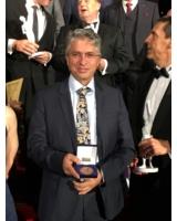 Saeid Fasihi bei der Galaveranstaltung mit der Ehrenplakette. Foto: Martin