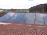 Photovoltaikanlage auf dem Dach des Sportparks Miesbach erbaut von Green City Energy