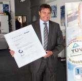 TÜV-Zertifikat für Bürotechnik Schmitt, vertreten durch Geschäftsführer Jürgen Hess