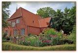 Bauenrgarten mit Rosen des Haus Peters