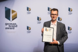 "Georg Obermayr, Crossmedia-Leiter bei ADVERMA, nahm in Berlin den ""Special Mention"" entgegen."