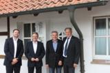 Von links: Niels Köstring, Achim Post, Wilhelm Henke und Heiko Köstring unterhalten sich über BPTL