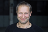 """Niki Schelle, ehemaliger Werksfahrer und Moderator des TV-Magazins """"GRIP"""""""