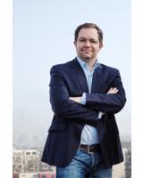 CEO und Gründer von Exozet, Frank Zahn, äußert sich zufrieden zum ersten Halbjahr.